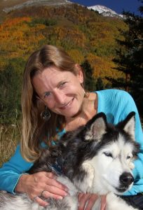 Kim Wheels and husky in Ophir, Colorado